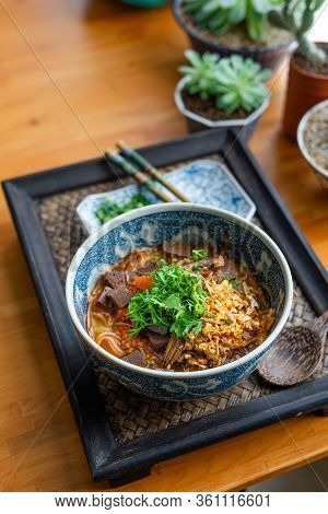 Rice Noodles With Spicy Pork Sauce (nam Ngiao) On Black Table, Thai Food.