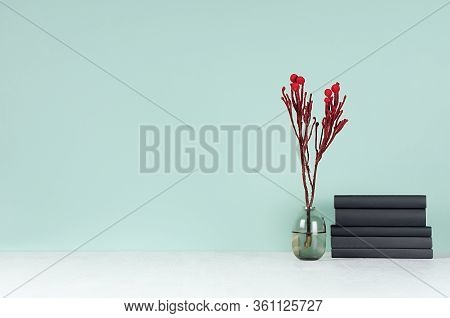 Modern Elegant Home Workplace With Black Books, Glass Vase With Red Branch In Green Mint Menthe Inte