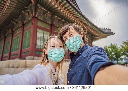 Young Couple Of Spouses In Medical Mask. Bride And Groom, A Husband And Wife, Boyfriend And Girlfrie