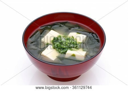 Japanese Food, Miso Soup Of Tofu And Seaweed Wakame In A Bowl On White Background