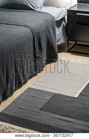 Interior Of Illuminated Modern Bedroom With Geometric Carpet