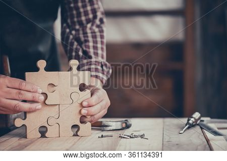 Carpenter Working In Carpentry Shop. Woodwork For Puzzle And Home Decor Making Concept. Diy Wood Jig