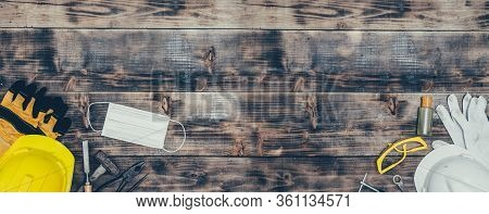 Labor Day Concept On Wood Background. Engineer And Worker Tools With Construction Safety Equipment A