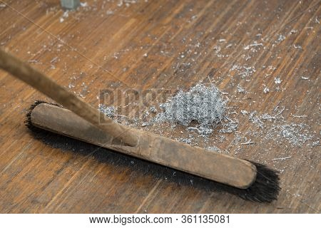 Workshop To Clean Metal Shavings With Wooden Broom - Close Up Broom