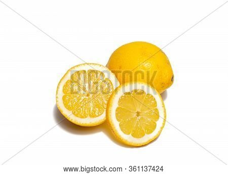 Lemons On White Background. Pieces Of Lemons And Whole Lemons, With Little Shadow. Groups Of Yellow