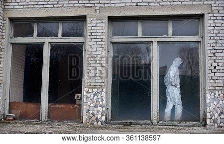 Full Length Of Male Environmentalist Standing Inside Old Brick House With Large Windows. Scientist W