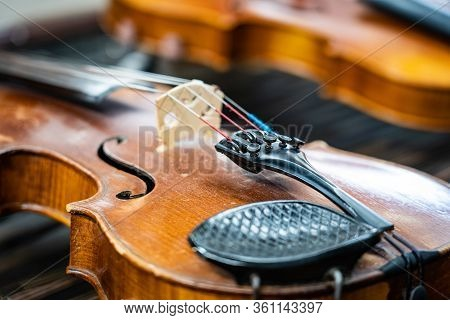 Antique Violin And Violin Bow Lying On Dulcimer. Close Up A Violin Instrument And Cymbal Before A Co