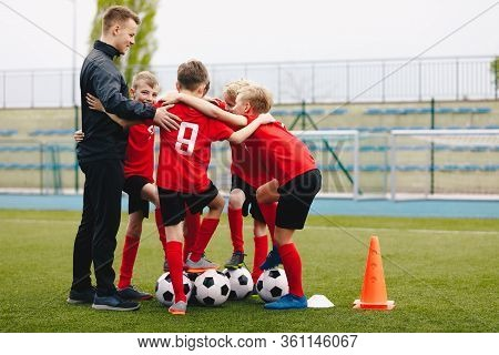 Coach Giving Young Soccer Team Instructions. Kids Sport Team Gathering. Children Play Sports. Boys I