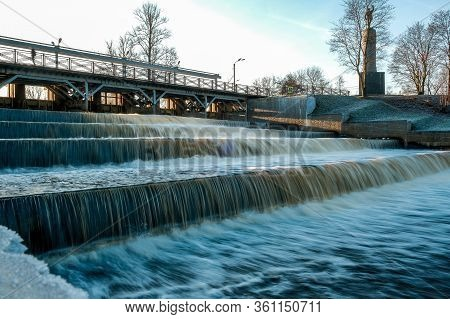 The Beautiful Small Waterfall In The City Park