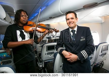 Johannesburg, South Africa - February 06, 2014: African Musician Playing A Violin On Board A Airbus