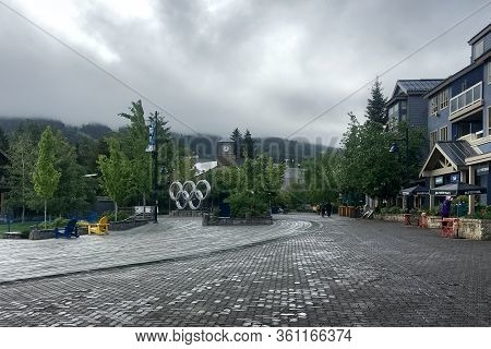 Whistler, Bc, Canada - June 4, 2018. Olympic Rings At Olympic Plaza On A Rainy Summer Day.  Whistler