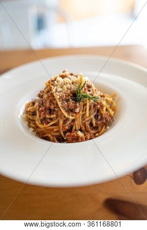 Spaghetti Bolognese Served On A White Plate