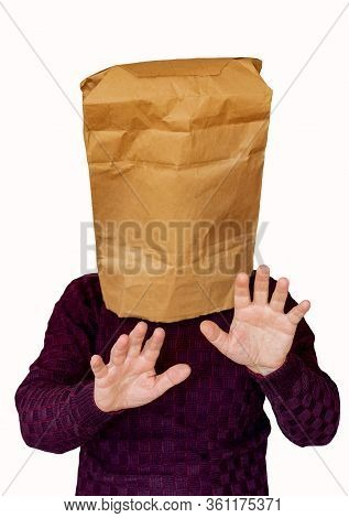 Man With A Package On His Head On A White Isolated Background. The Man Looking By Feel Road