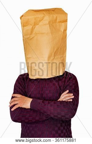 Man With Crossed Arms And Paper Bag On His Head On White Isolated Background. Concept Of Isolation,