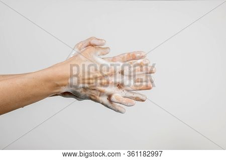 Close Up Of Caucasian Woman Washing Her Hands Isolated On White Background. Demonstration Of Hand Wa