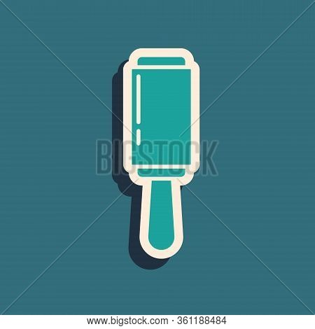 Green Adhesive Roller For Cleaning Clothes Icon Isolated On Green Background. Getting Rid Of Debris,