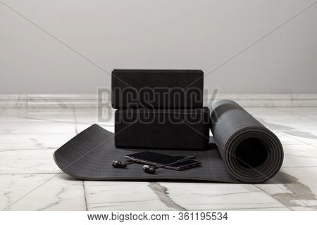 Composition Of Sports Objects. Mens Sports Accessories For Yoga. Black And Gray Color. Yoga Mat, Foa