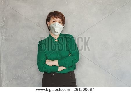 Mid Adult Woman In Safety Medical Face Mask Portrait
