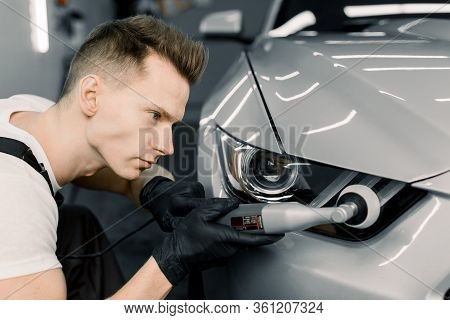 Car Detailing Series, Polishing Concept. Professional Caucasian Male Auto Service Worker, Wearing Bl