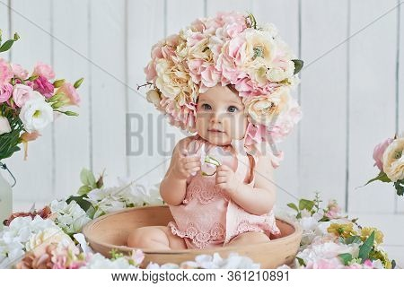 Sweet Funny Baby In Hat With Flowers. Easter Greeting Card, Copyspace For Your Text. Poster For East