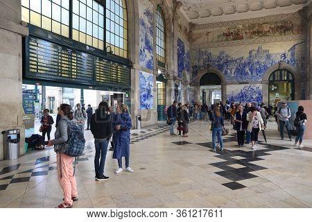 Porto, Portugal - May 24, 2018: People Visit Sao Bento Station In Porto, Portugal. The Railway Stati