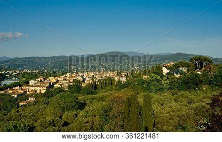 Sunny Tuscan Landscape As Seen From The Piazzale Michelangelo In Florence, With The Arno River At Fa