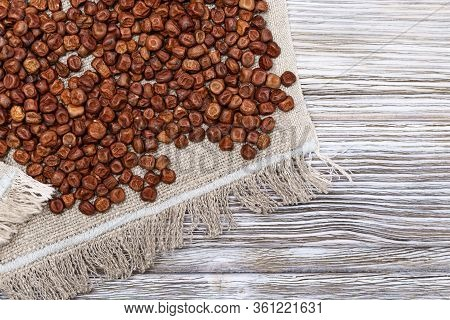 Raw Gray Peas On Coarse Cloth On Light Wooden Background. Organic Healthy Diet Food. Traditional Lat