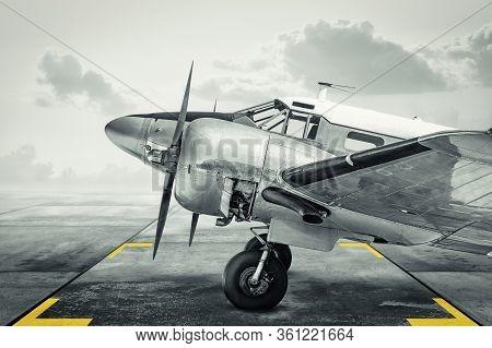 Historical Aircraft On An Airfield Against A Dramatic Sky