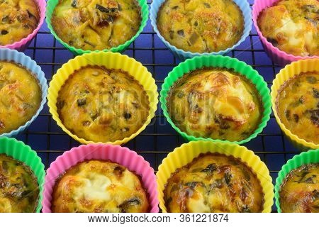 Warm Baked Scrambled Egg Cups With Chopped Mushrooms, Bell Peppers And Onions In Silicone Muffin Cup