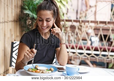 Eating Out, Lifestyle And Travelling Concept. Portrait Of Pretty European Woman Eating At Restaurant