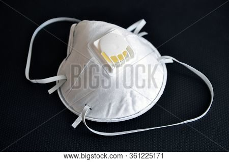 Respiratory Protective Mask, Effective Against Influenza Viruses And Coronavirus, On A Black Backgro