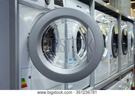 Open Door Of A Washing Machine In A Household Appliance Store.