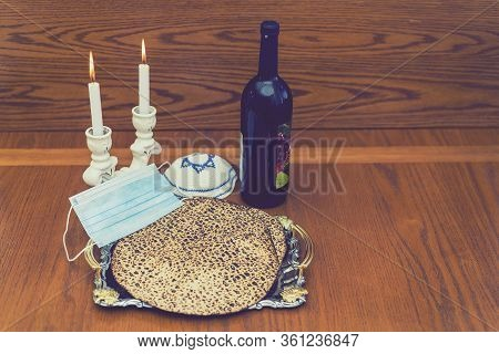 Corona Passover. Dust Mask, Bottle Of Wine And Matzah - A Traditional Jewish Food For Passover. Smal