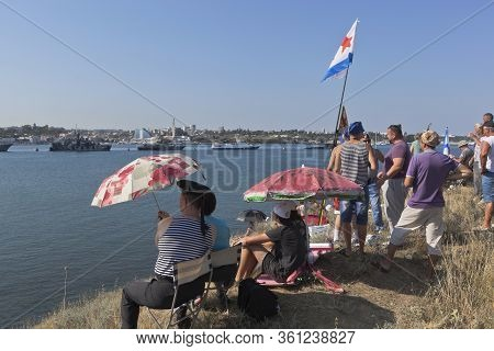 Sevastopol, Crimea, Russia - July 28, 2019: People Watch The Parade On Navy Day From The North Side