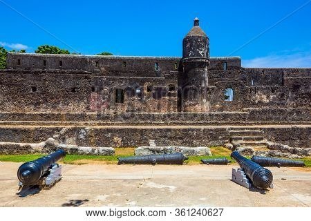 Bastion and loopholes in the thick ancient walls. UNESCO listed Fort as World Heritage Site. Fort Jesus -  medieval fortification in Mombasa, Kenya. The concept of historical, educational tourism