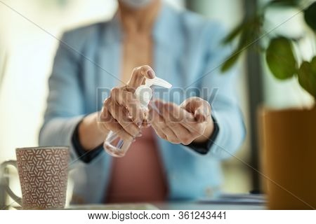 Close-up Of A Unrecognizable Business Woman Uses Antibacterial Antiseptic Gel For Hands Disinfection