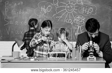 Fascinating Chemistry Lesson. Man Bearded Teacher And Pupils With Test Tubes In Classroom. Observe R