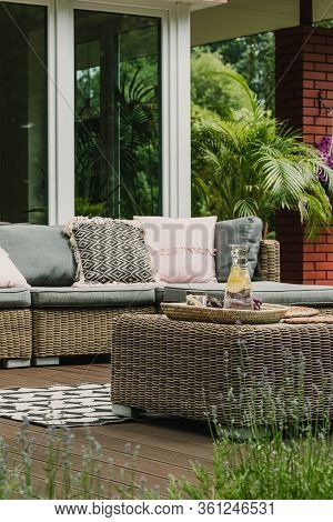 Drinks On Wicker Coffee Table Cute Patio With Comfy Sofa
