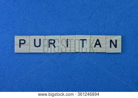 Text From A Short Word Puritan From Gray Small Wooden Letters On A Blue Table