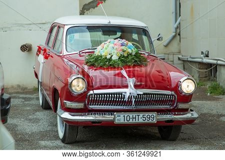 Unusual Front Headlight, Old Burgundy Red Car For Any Purpose . Red Vintage Wedding Car Parked . Wed