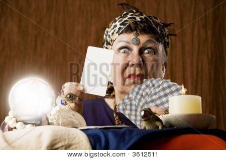 Gyspy With Blank Tarot Card And Crystal Ball