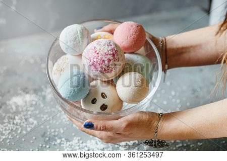 Female Hands On A Light Background Hold A Bowl Full Of Multi-colored Balls For A Bath, Handmade. Pre