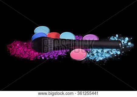 Makeup Brushes And Colorful Eyeshadows On A Black Background, Top View. Colorful Crushed Eyeshadow P