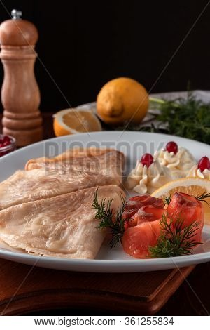 Pancakes With Red Fish, Lemon And Cranberries On A White Plate, Table Served In Restaurant In Rustic