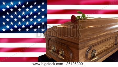 funeral and mourning concept - red rose flower on wooden coffin over flag of united states of america on background