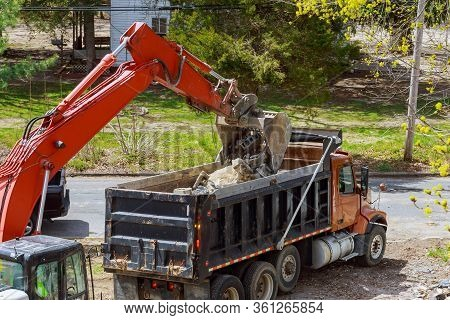 Truck With Excavator Loading For Removal Of Waste Building Demolition Debris Construction