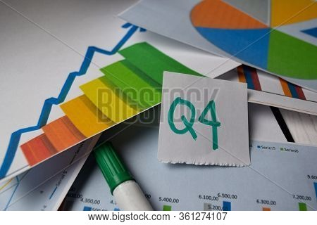 Q4 4th Quarter Period Write On Sticky Notes Isolated On Office Desk. Stock Market Concept