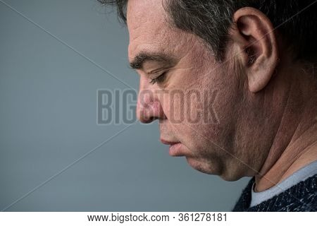 Double chin. Profile face of a mature man