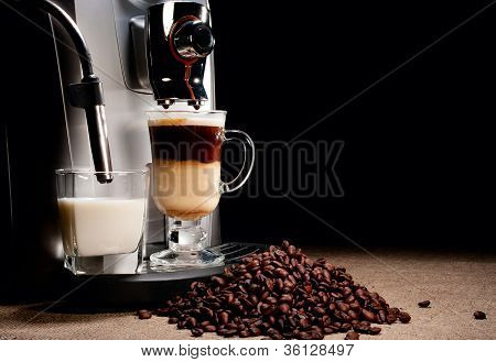 Coffee Machine And Beans Heap