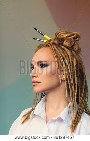 Portrait High Fashion Model False Dreadlocks. Smokey Eyes. Ethnic Style. Cheeky Image. Art Salon Con